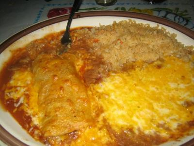 One beef enchilada, beans and rice